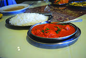 Cleveland Heights Cafe Tandoor's butter chicken is a flavorful and vibrant dish. The samosas, biryanis and naan are also recommended.