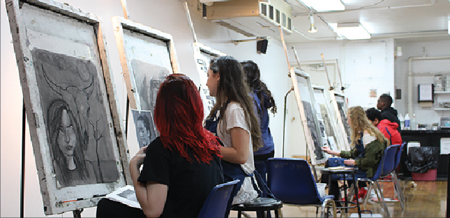 First+period+Honors+Drawing+students+Payton+Clark+and+Sophie+Browner+work+on+their+self-portrait+assignment.+Though+Shaker+does+not+offer+STEAM-structered+courses%2C+there+is+an+extensive+arts+program.