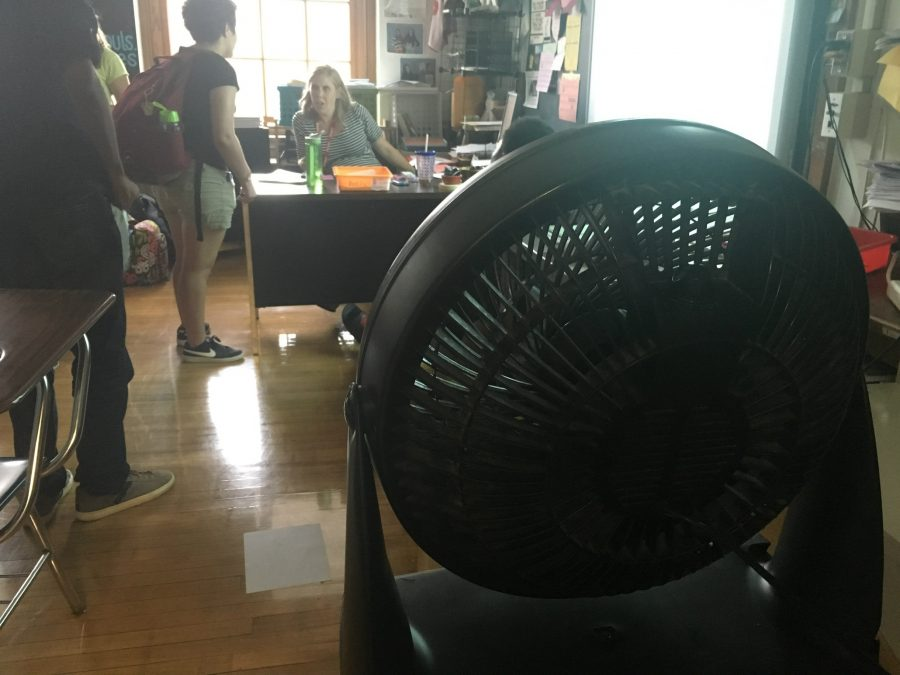 Students+in+history+teacher+Amanda+Ersek%27s+conference+period+sweat+in+the+intense+heat+despite+a+fan.