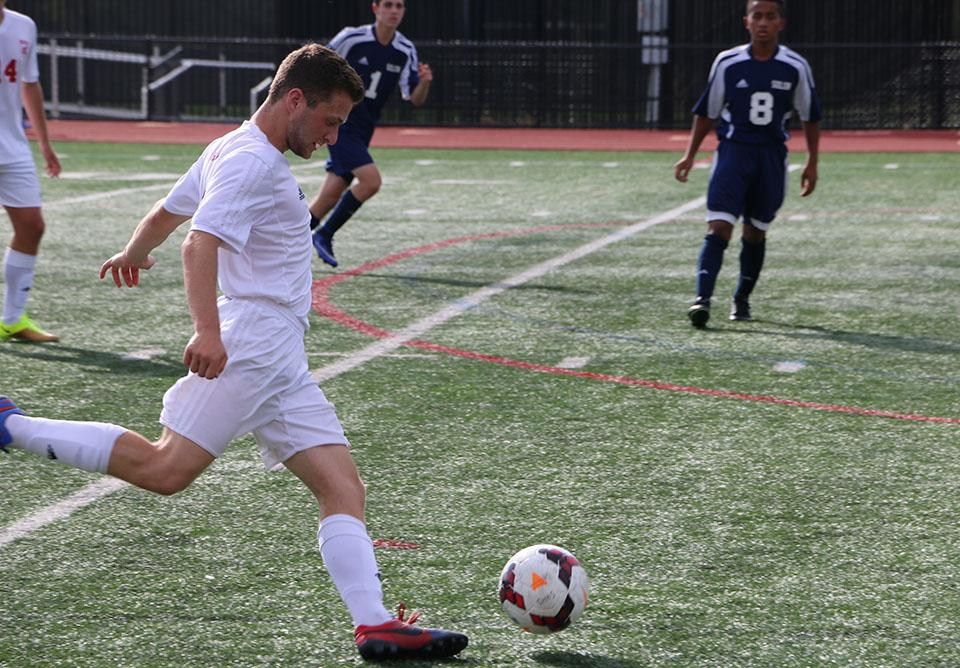 Senior forward Andrew Roth drives the ball forward during a 2-0 win against Solon.