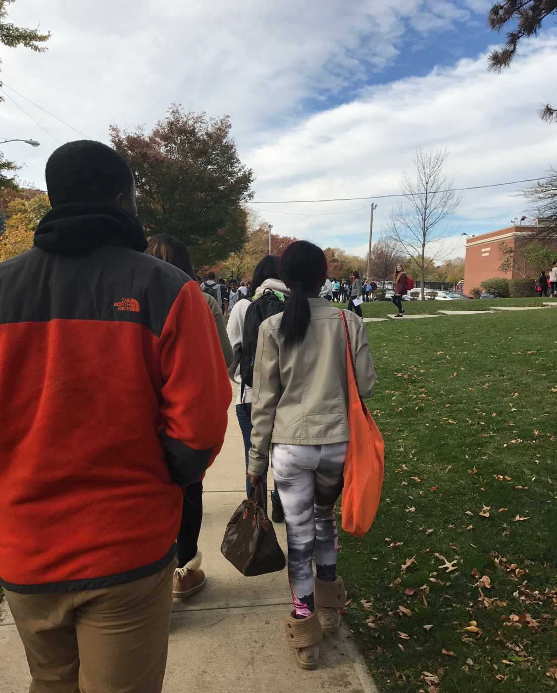 Students exit the high school after ending lockdown.