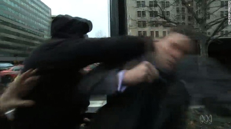 A protestor punches alt-right leader Richard Spencer during Spencer's Jan. 20 interview with the Australian Broadcasting Company.