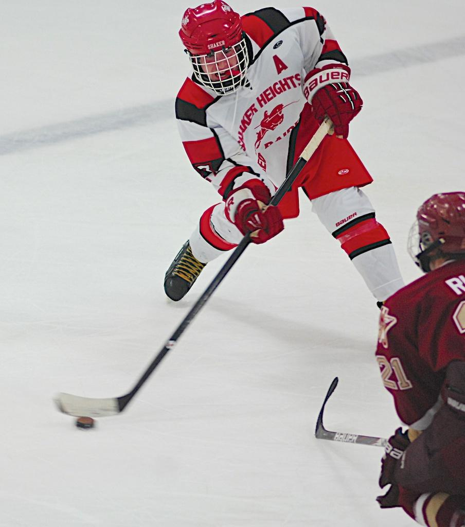 Junior+Nathan+Christman+passes+the+puck+to+Peter+Shick+in+overtime.+The+Raiders+will+take+on+Avon+in+the+Thanksgiving+Tournament+on+Nov.+29.%0A