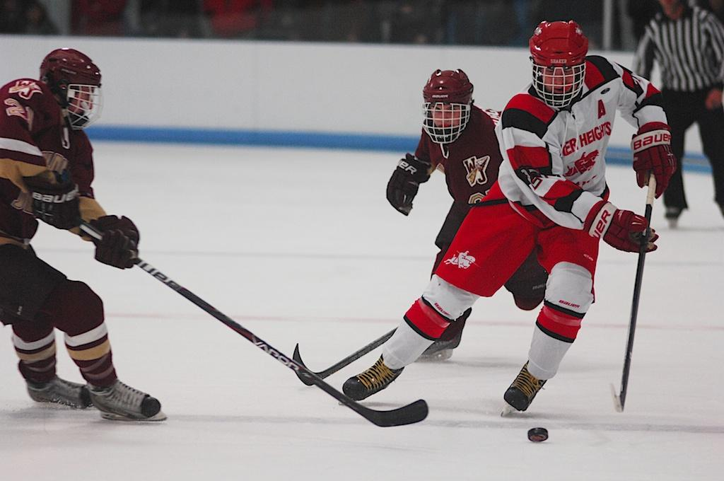 Junior+Nathan+Christman+fights+off+a+Walsh+Jesuit+defenseman+during+Shaker%E2%80%99s+first+home+game+of+the+season+against+Walsh+Jesuit+High+School+Friday+Nov.+22.+%0A