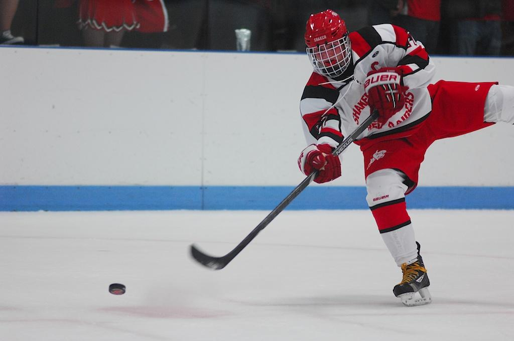Senior+captain+Ryan+LaMonica+swats+the+puck+towards+Walsh+Jesuit+High+School%E2%80%99s+goal.+The+Raiders+defeated+Walsh+Jesuit+2-1.+The+Raiders+are+currently+ranked+third+in+Ohio.%0A