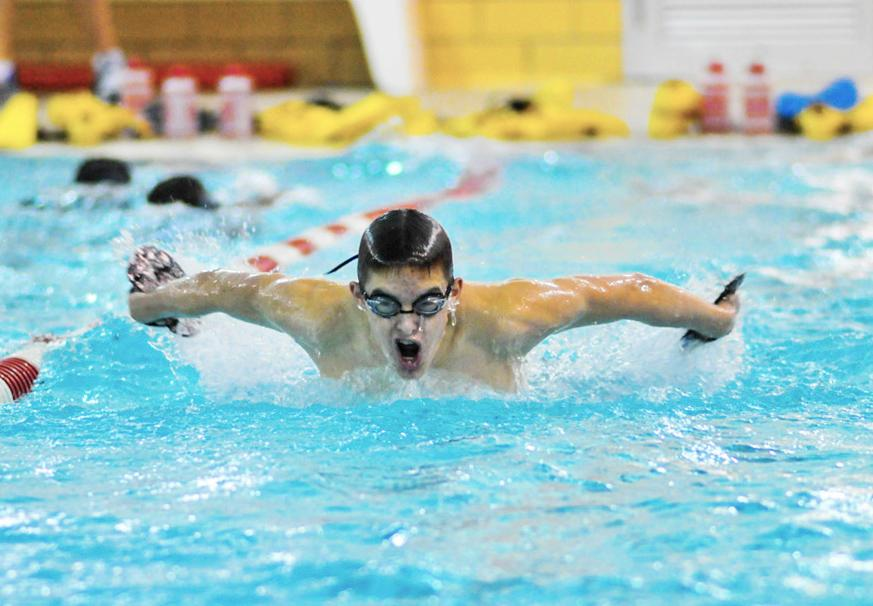 Varsity swimmer Austin Yoder, a junior, comes up for air while doing a 50-yard butterfly warm up during an afternoon swim practice Dec. 2 at the Woodbury pool. The Raiders' first swim meet will be against Willoughby South High School Dec. 13 at home.