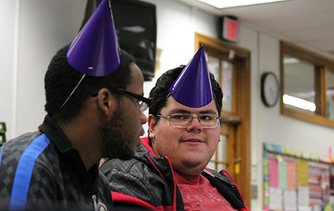 Seniors Joshua Beckles and Mauricio Rivas sport purple party hats identifying them as English teacher Valerie Doersen's students during conferences in Room 109 Nov. 25. Said Rivas,