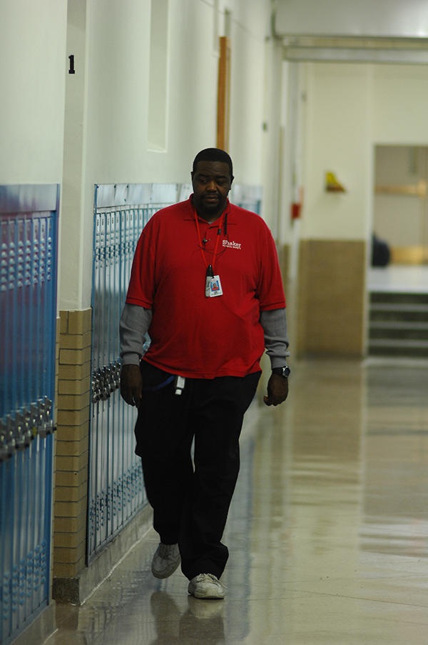 A security guard walks past Room 131 Nov. 13.