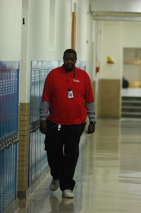 A+security+guard+walks+past+Room+131+Nov.+13.