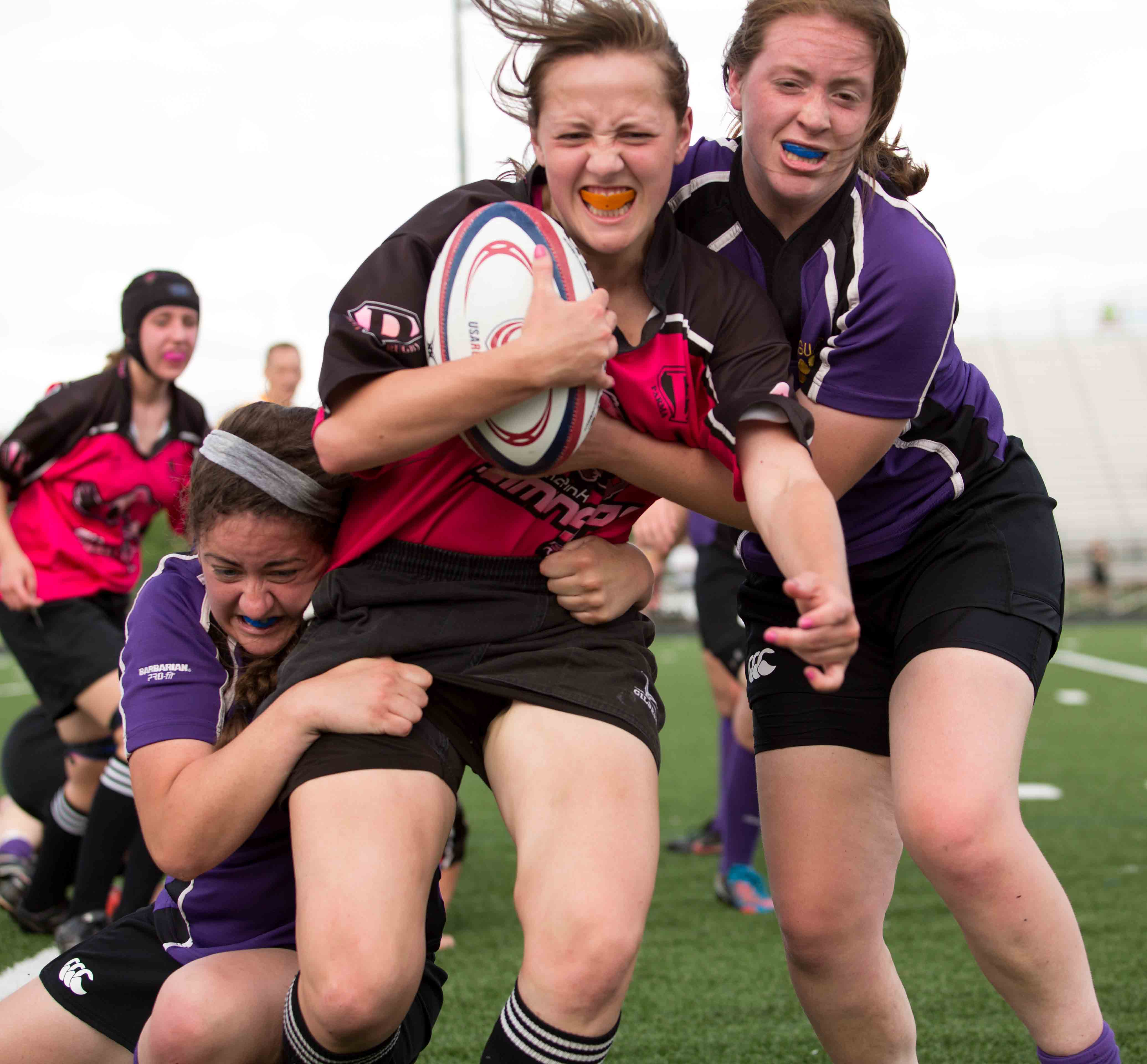 A member of the Parma High School women's rugby team, the Flamingos, struggles to escape the grasp of two St. Joseph Academy Jaguar opponents. Shaker's women's rugby team will compete against St. Joseph in Division II play.