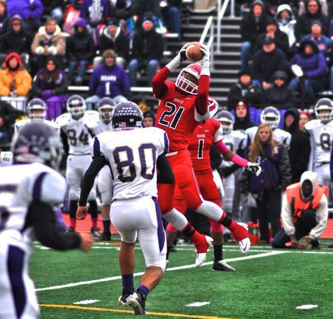 Senior wide receiver Trey Johnson catches the ball for a touchdown against North Royalton on Saturday, Oct. 26, 2013. The Raiders beat North Royalton 42-33.