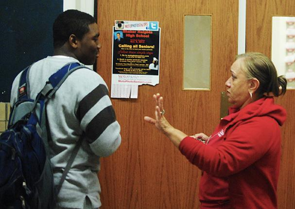 "Security guard Linda Copeland stops a student from entering the Upper Cafeteria Oct. 7 at 3:20 p.m. Superintendent Gregory C. Hutchings said that the district and school are working on determining ""vulnerable areas"" that need more attention from security personnel."
