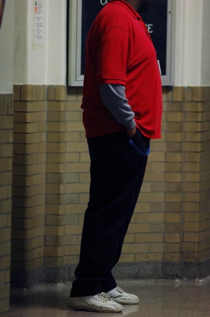 A security guard stands outside the library Nov. 13. Photo by Andrew Boyle.