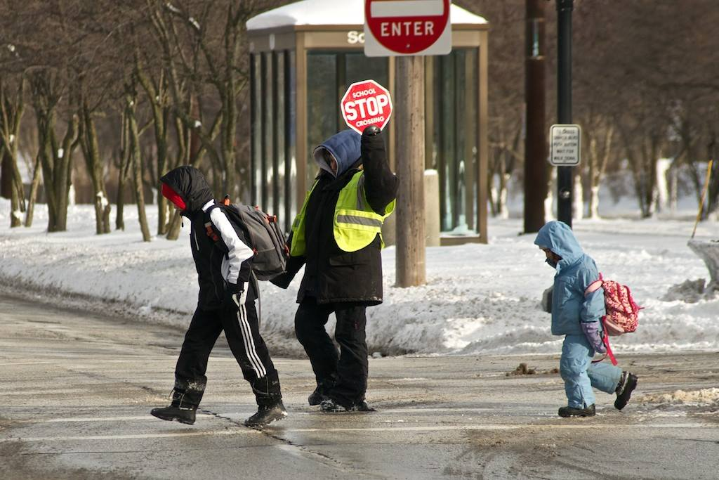 Students cross the street after school Monday, Jan. 27. Shaker schools were closed the following day, Jan. 28, due to frigid wind chills.