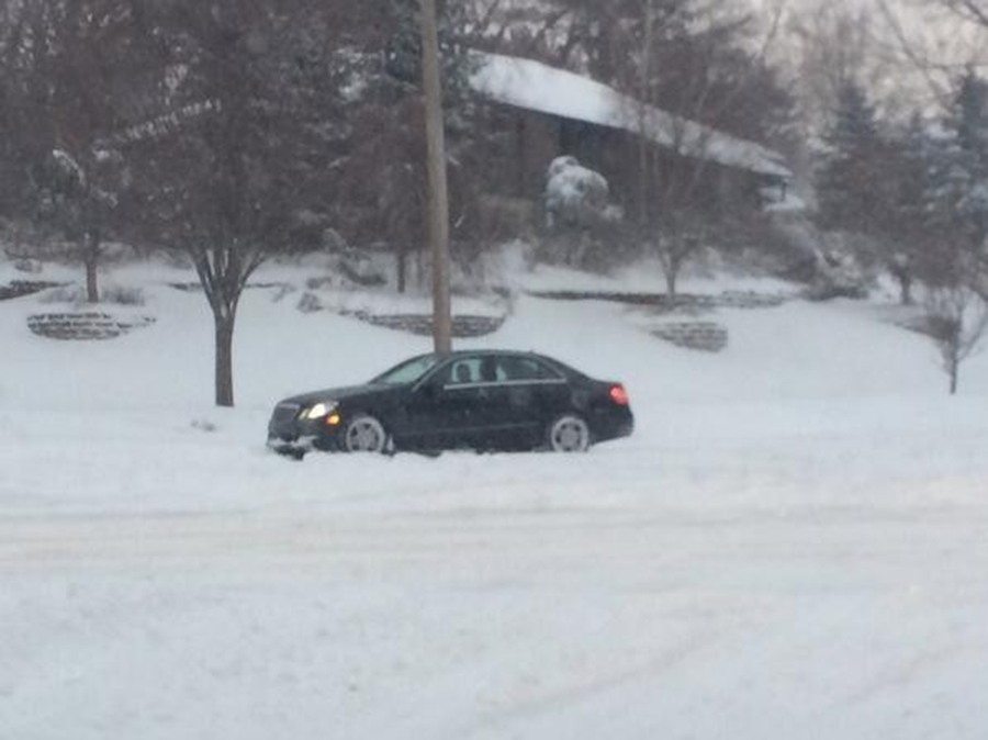 This car was stuck in the snow on Shelburne Road for more than five minutes during the morning of Feb. 18. Hutchings did not cancel school that Tuesday in part because of the high schools delayed start.