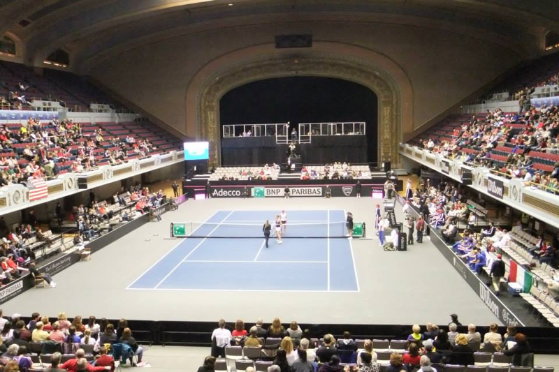 The crowd and the tennis players prepare for the first match of the Fed Cup on Feb. 8, 2014.