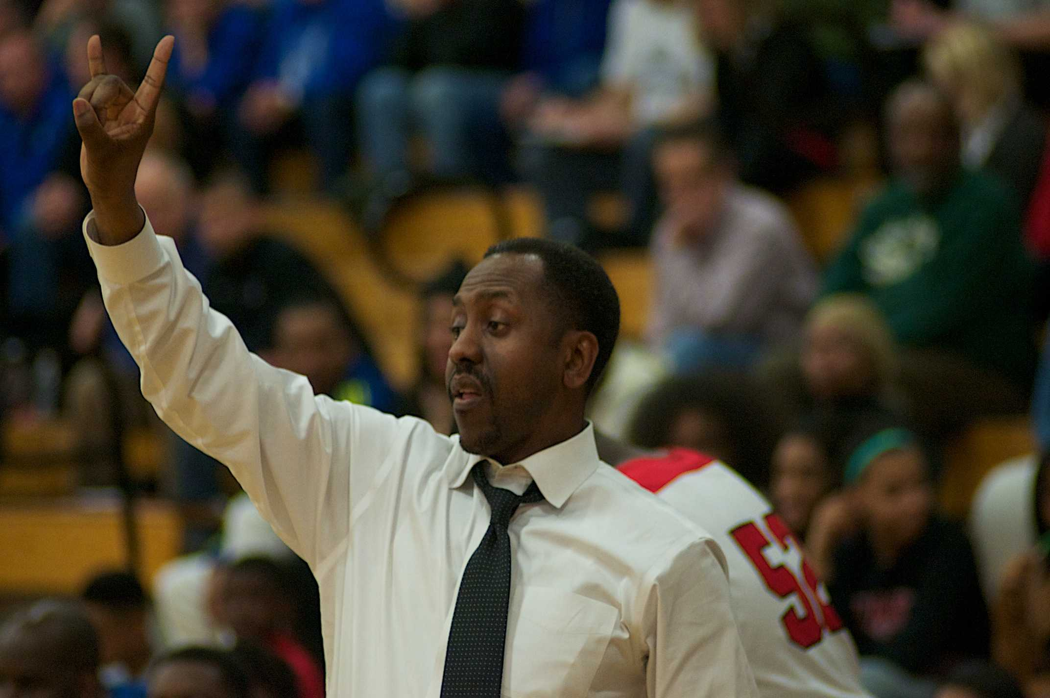 Middle School Principal Danny Young coaches the high school men's basketball team. Young will replace Randall Yates as Woodbury principal next year.