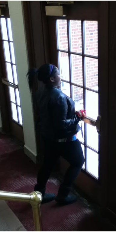 Freshman Sienna Jackson struggles to open the sticky door in the Large Auditorium lobby Feb. 23.