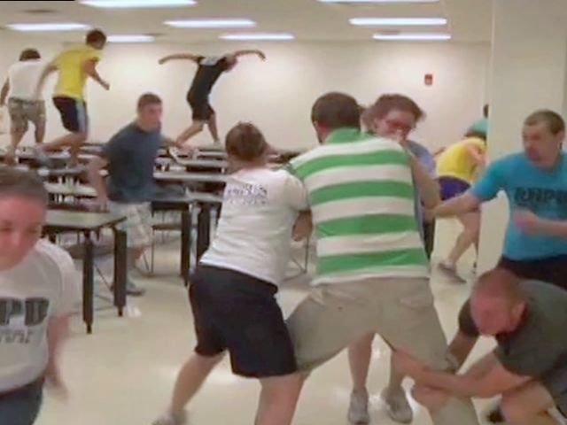In a training exercise, some high school students practice overwhelming an intruder while others evacuate the scene. As school shootings have continued, schools and law enforcement agencies have begun to adopt and rehearse more aggressive responses than the lockdowns legislated throughout the country in the years following the assault at Columbine High School 15 years ago.