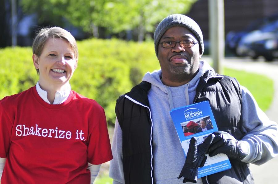 Board of Education member Amy H. Fulford and another Shaker resident campaign outside Woodbury Elementary School May 6.