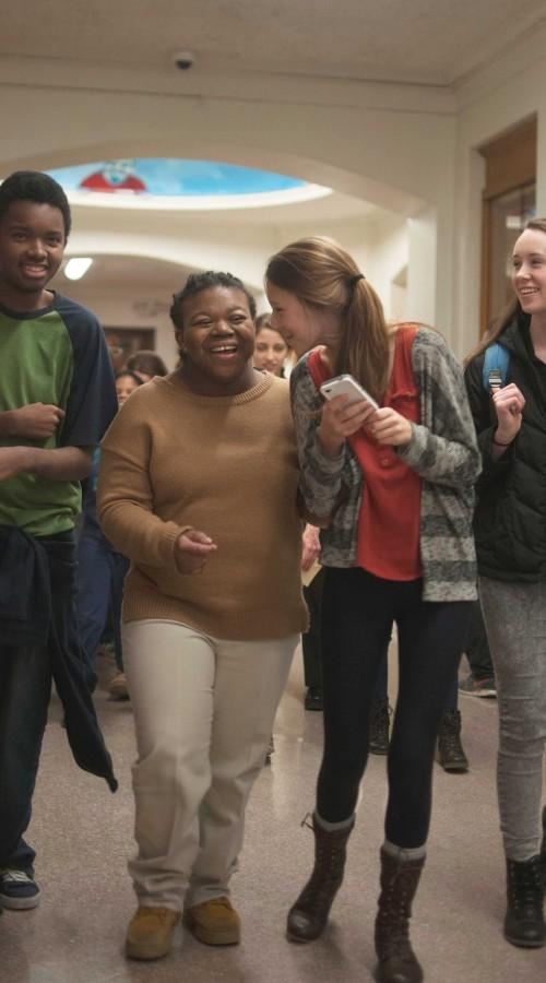 Freshmen Andre Pettis, Luxus Flowers and Nadia DiGeorgia walk with junior Maeve Cook through the high school halls on a Project Support scavenger hunt March 15.