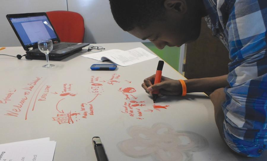 Sophomore Davionne Gooden works on the plot for a video game he is designing May 24. He does most of his work at LaunchHouse, an institute for startup businesses, like Gooden's, in Cleveland. He plans to sell his two most recent video games,
