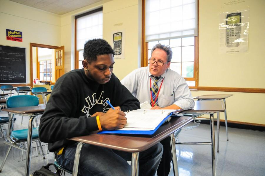 Math teacher Tom Anderson helps senior Brandon Draper during conferences Sept. 11.
