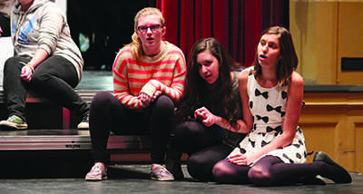 "Members of the ""Les Miserables"" ensemble practice a scene in the Large Auditorium at an after-school rehearsal."