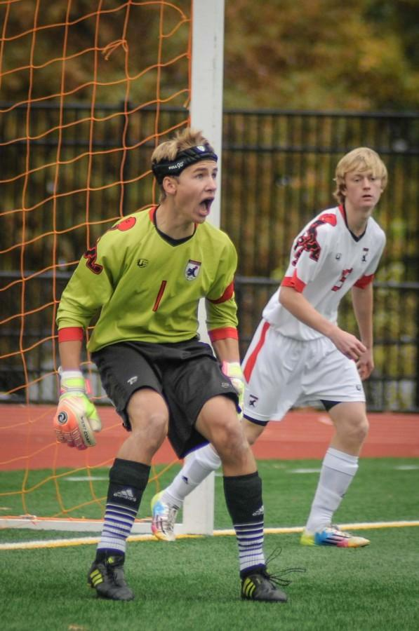 Junior goalie Vincent Prochoroff yells to his teammates during a home game on the turf field at Russell H. Rupp Stadium