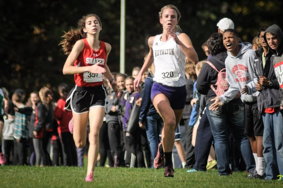 Freshman Tessa Shlonsky runs neck and neck with a North Royalton opponent Oct. 11 at the Northeast Ohio Confrence River Division Meet. Women's cross country placed fourth out of six teams at the meet. Shaker placed 11th at regionals Oct. 25 and sophomore Mimi Reimers advanced to states.