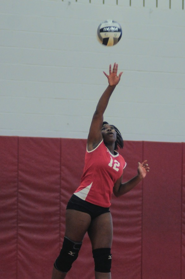 Senior volleyball player Nazhary Jackson hits the ball during a game against Beachwood High School Sept. 4.