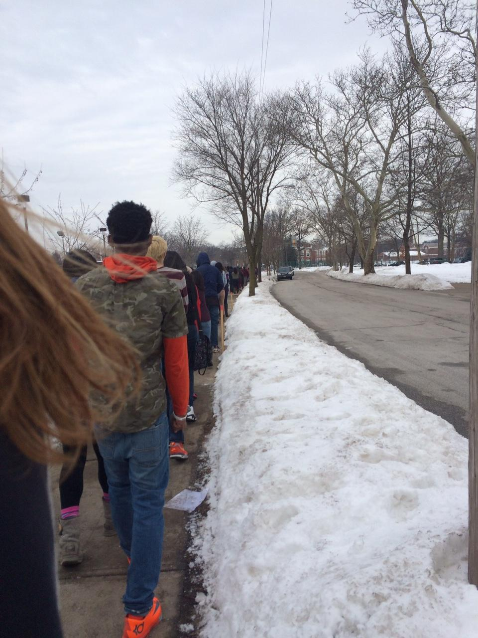 Students walk outside during a fire drill Feb. 11.