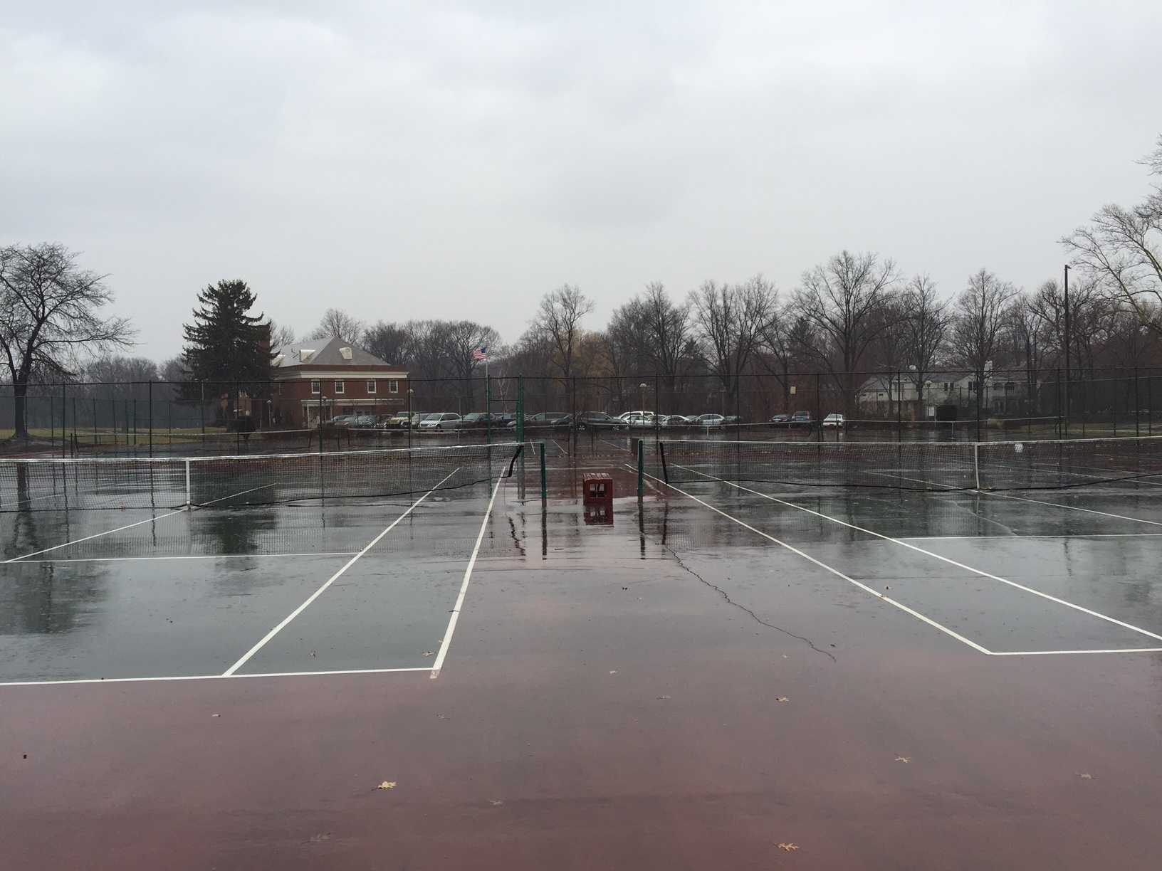 The tennis courts near Onaway Elementary School were flooded after snow melting.