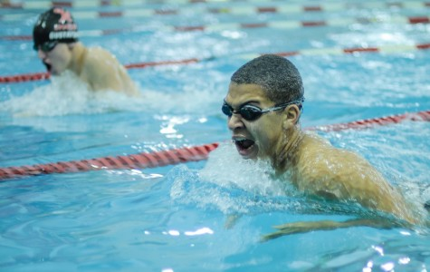 Senior August Whitley and sophomore Max Gustafson swim during the Raiders' red-white scrimmage