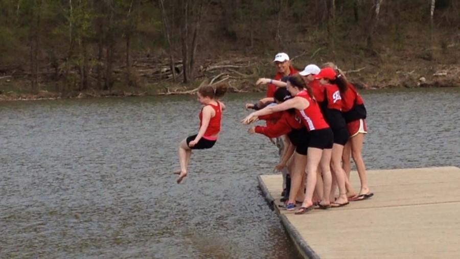 Women's Crew throws coxswain Samantha Rose into the Cuyahoga River after a winning meet.