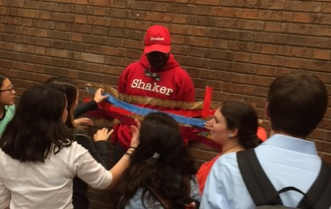 Students rush to tape up Superintendent Dr. Gregory C. Hutchings for $1.