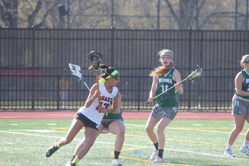 Sophomore Haley Brady goes in for a shot April 28, 2015.