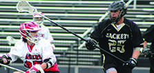 Sophomore Will Talbot plays a lacrosse game in spring 2015.