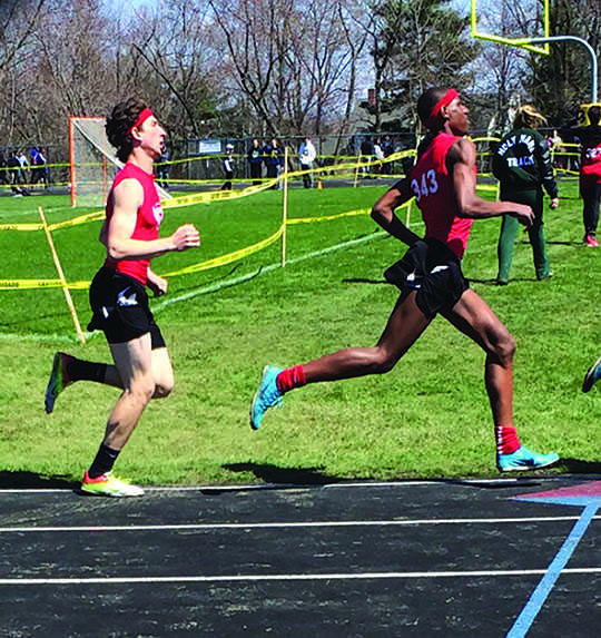 Senior Brian Lief and junior Justyn Moore compete in a meet.