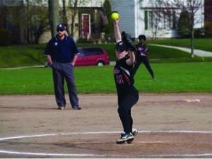 Freshman Ellen Meyerhoefer winds up a pitch during a game.