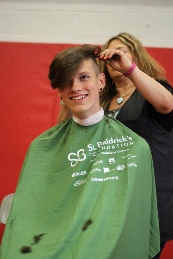 Freshman Max Landow gets his head shaven at the St. Baldrick's event May 29.