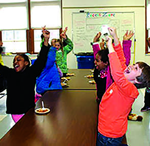 Onaway Elementary School third grade students cheer as their dish, spinach lasagna, wins during the menu tasting competition. Dish ideas brought up by the three third grade classes were tested to see which dish will be on the menu next year.