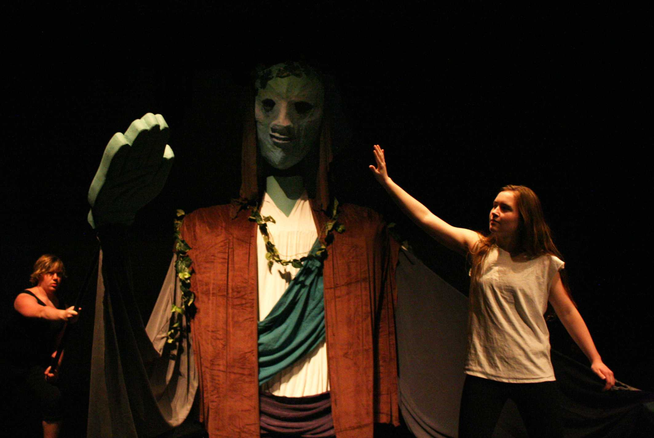 Freshman Ruby Gibson pushes back the Prospero puppet's hand, held up by senior Noah Silberman.