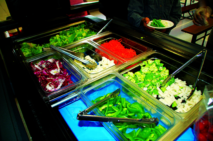 The Offering Bar, the new, smaller salad bar filled with vegetables at Onaway, is pictured above. Parents and creators Stacey Hren and Jenny Steadman routinely challenge the students' taste buds with new vegetables. On this day, they tried radicchio, a bitter purple lettuce.