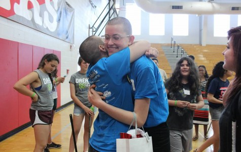 Freshman Sophia Solganik and Emma Duhamel embrace after both shaving their heads for St. Baldrick's.