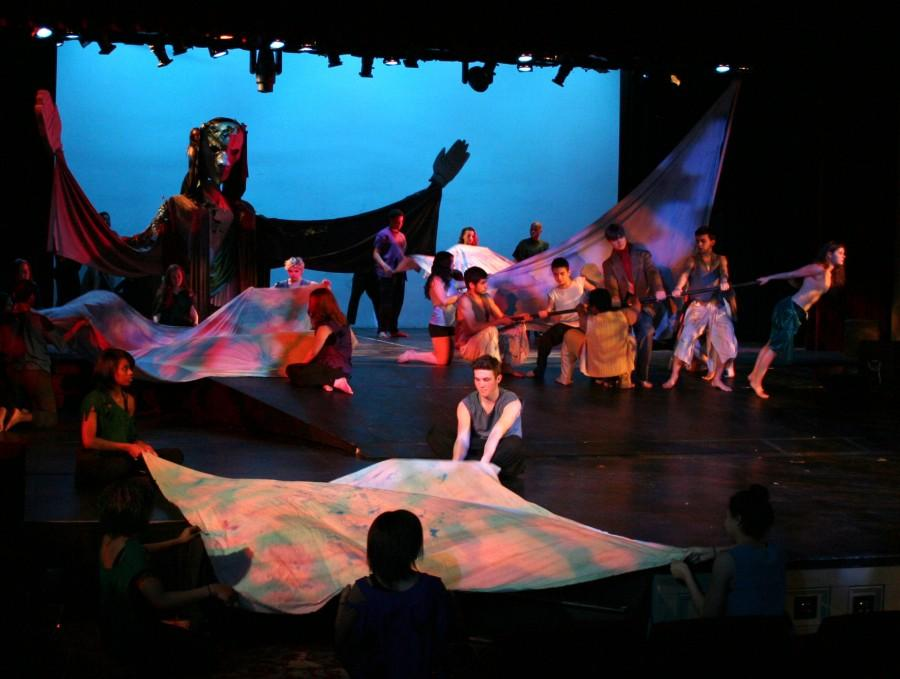 Members of all three ensemble classes make a storm, conducted by the wizard Prospero.