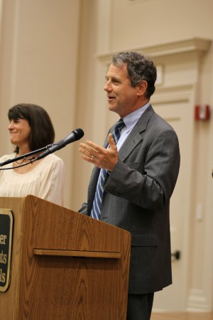 Sen. Sherrod Brown speaks at the press conference event with English teacher Jody Podl and concerned parent Jennie Kaffen.