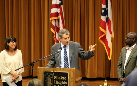 Sen. Sherrod Brown, flanked by English teacher Jody Podl and Superintendent Gregory C. Hutchings, Jr.,  promotes the SMART Act, legislation designed to curb standardized testing in public schools, today during a press conference in the high school's small auditorium.