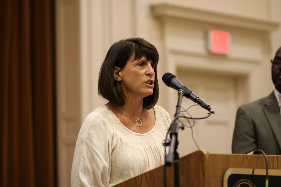 English teacher Jody Podl speaks during the press conference June 8.
