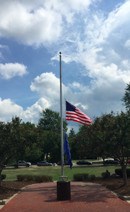 The high school's flags fly at at staff to commemorate the 14th anniversary of the Sept. 11, 2001 terrorist attacks. Interim Principal James Reed addressed the school second period today.
